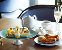 Afternoon tea set with glass of champagne